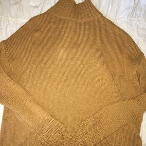 ochre yellow turtleneck sweater